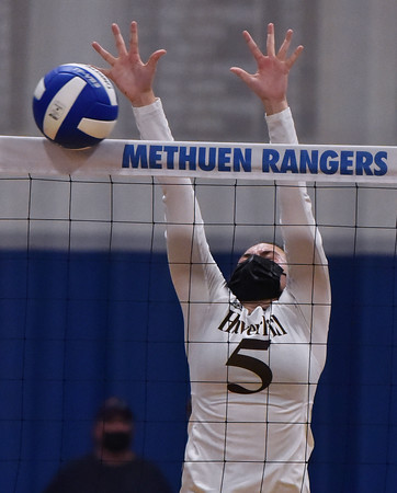 Haverhil vs Methuen high in Volleyball action