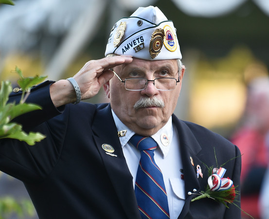 CARL RUSSO/Staff photo Navy submarine veteran, Gerard Marchand, Mass State AMVETS commander and past Haverhill commander offers a salute during the ceremony. Haverhill's Vietnam Memorial Commission held the formal dedication of the Vietnam Veterans' Memorial at Millbrook Park on Saturday night, September 11. <br /> <br /> The Commission members chose this day to honor Vietnam veterans and those who died in the war, to recognize the 13 members of the military who were killed in Afghanistan recently, and to remember those who perished in the 911 terrorist attacks.<br /> 9/11/2021