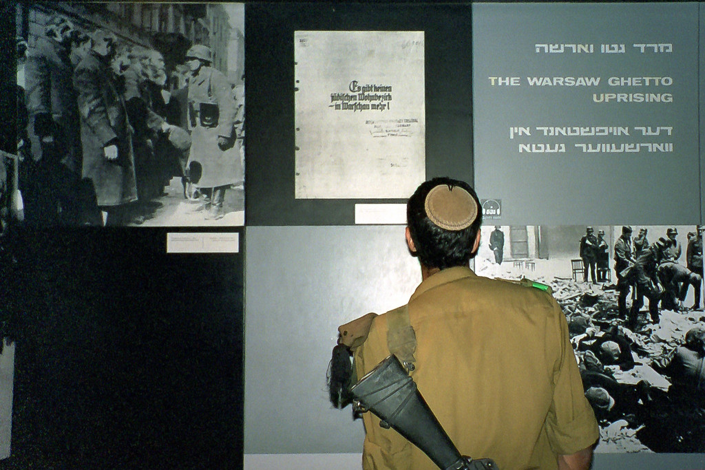 "July 2000, Jerusalem, Israel - ""Israeli Soldier at Holocaust Museum"".  During a trip to Israel in 2000, I visited a museum at Yad Vashem, which is a collection of museums, sculptures and monuments dedicated to remembering the holocaust.  At this and many other historical sites I saw members of the Israeli Army, not to protect but actually to study.  This soldier was particularly intent and I can only imagine what was going on in his mind.  Even though this was over ten years ago, I still think of this moment when I'm stressed or sad and then somehow my problems don't seem like that big of a deal anymore."