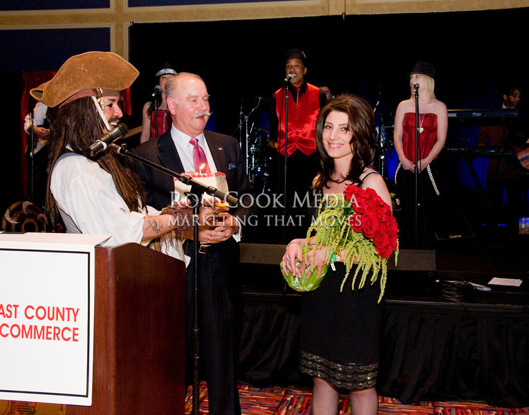 Chairman of the Board Roger Roberts and Sam the Pirate presenting Renae Arabo with a gorgeous bouquet of Birthday Roses