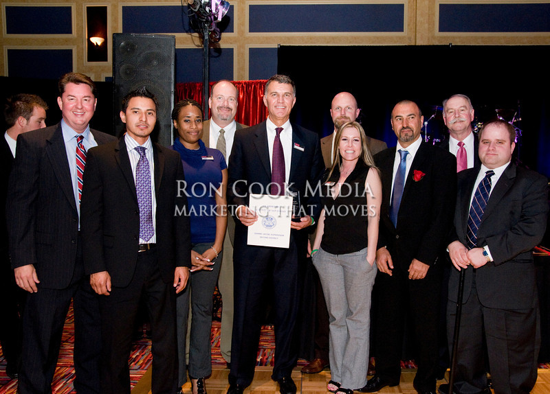 CEO Mike Cully and Roger Roberts with the team from DCH Honda, winner of the City of Lemon Grove Large Business of the Year
