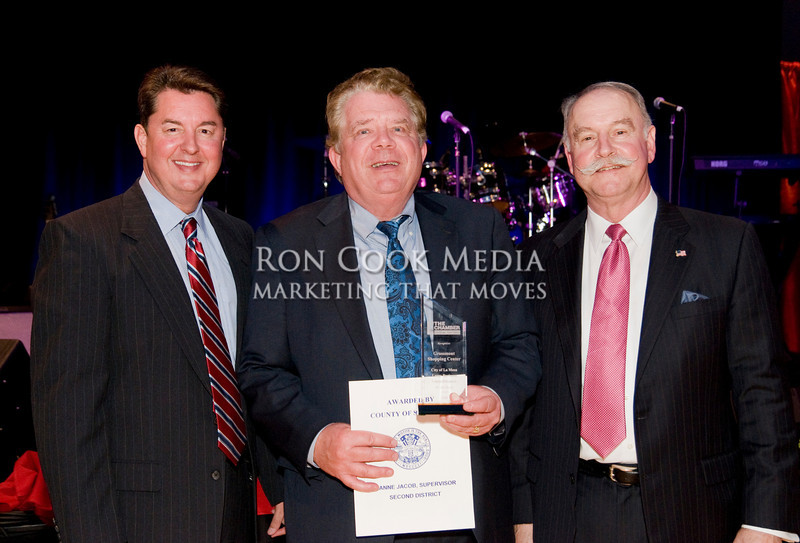 CEO Mike Cully, Mike Hansen from Grossmont Shopping Center, winner of the City of La Mesa Large Business of the Year, and Chairman of the Board Roger Roberts