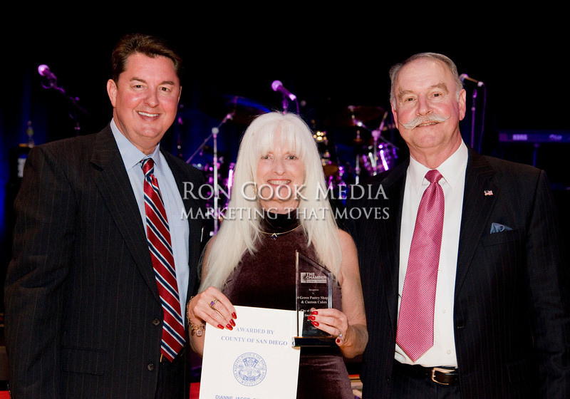 CEO Mike Cully, Teresa Johnson, owner of Grove Pastry Shop and winner of Lemon Grove Small Business of the Year, with Chairman of the Board Roger Roberts