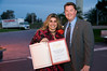 Mike Cully, CEO of the East County Chamber of Commerce, presents Senate recognition to Leslie Rodriguez, Sales Manager of Marriott Residence Inn in San Diego.<br /> San Diego East County News