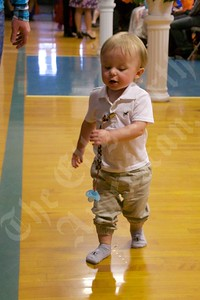 Taimi Pinkham trots across the gym floor at before graduation at Sumner Memorial High School.  He was there to see Tyler Hallet get his diploma.