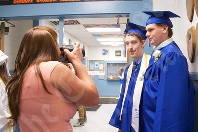 Alyssa Baltett takes a photo of her nephew, Daniel Weaver, far right, and his friend Neil Wilpan before graduation ceremonies at Sumner Memorial High School June 13.