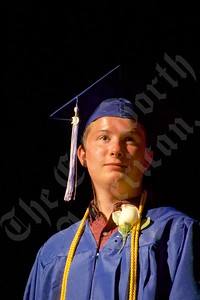 Trace Eastman smiles as he stands on stage just before getting his diploma from Sumner Memorial High School.