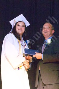 Superintendent Michael Eastman hands a high school diploma to his daughter, Meagan.