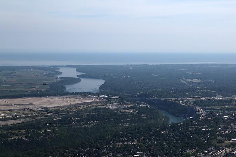 LZ5D7780<br /> Lewiston / Queenston Bridge middle. Lower Niagara River flowing into Lake Ontario past Fort Niagara.
