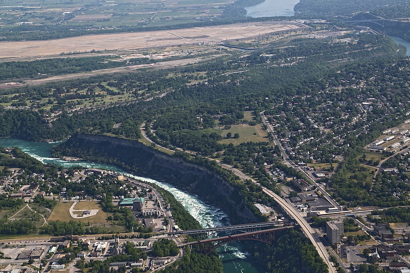 LZ5D7779<br /> Whirlpool Bridge below. Fastest section of the Lower Niagara River Rapids into the Whirlpool. Lewiston / Queenston Bridge top right.