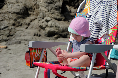Linnea doesn't like her feet in the sand and played with the sand from this chair.