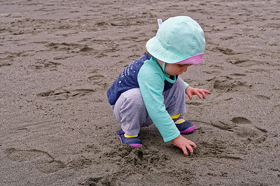 Linnea overcame her fear of the beach and started playing in the sand.