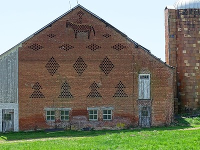 Horse and rider sit. atop a brick end barn along Rt. 16 in Greencastle, PA.