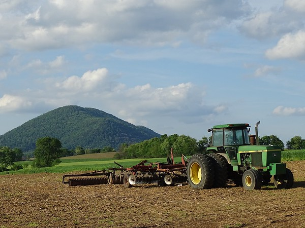 Equipment waits to continue after the farmer takes a supper break. Mercers burg, PA.