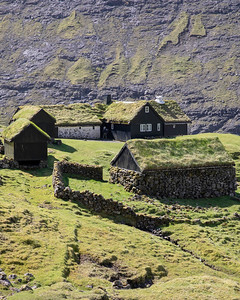 The Faroes have been inhabited since around the year 800 so there are plenty of old farm villages with stone walls and sod roofs.  This is the preserved village of Saksun