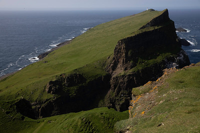 This is the famous island of Mykines with it's lighthouse.  You may think it looks steep, but when you hike out to the lighthouse you know it is steep!!