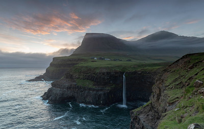 The Faroe Islands are famous for their waterfalls and towering mountains This is Gasadalur one of the most famous waterfalls on Vagar Island