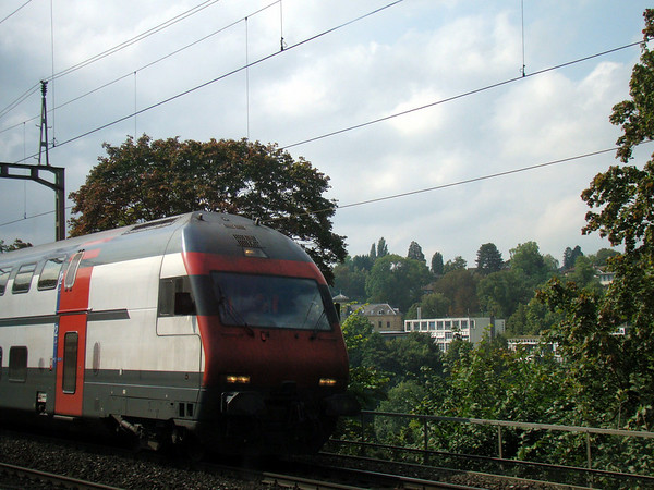 Swiss train pulling in to a train station. As I waited for my train from the Bern platform.