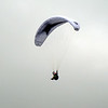 A paraglider soars high above Zurich.
