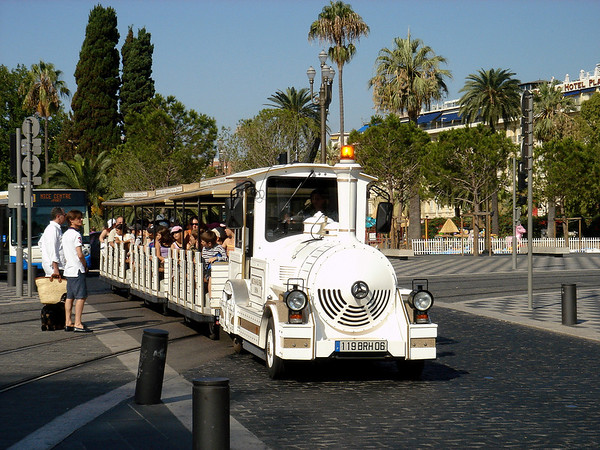 A tourist train traveling through the heart of Niece. <br /> <br /> The city of Nice is located on the French Riviera in Provence-Alpes-Côte d'Azur.  Blessed by a sunny, temperate climate, Nice attracts visitors from around the world.