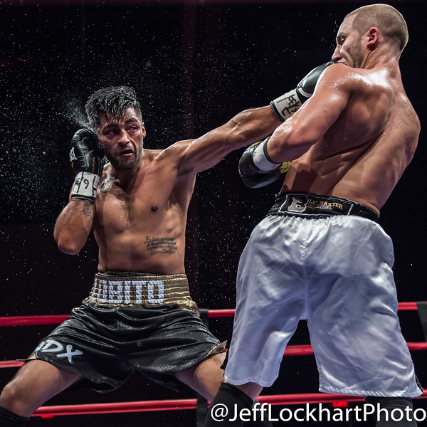 Kane Heron of Toronto (white) with UD over Luis Montelongo