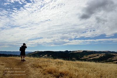 Hiker, clouds, and canyon in late summer, Coast Ranges, Santa Clara County, California