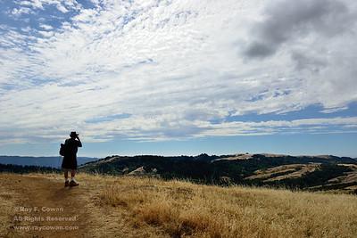 Hiker, clouds, and canyon in late summer, Coast Ranges, Santa Clara County, California