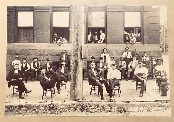 Hampden members sitting out alongside the 11th street side of the station. Photographer unknown.