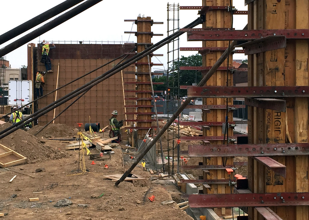 . Members of a construction crew work Wednesday, July 12, 2017, on the elevator shaft and the forms for columns that will be filled with concrete for the Lincoln Avenue apartment/retail building at The Foundry redevelopment project in downtown Loveland. (Photo by Craig Young / Loveland Reporter-Herald)