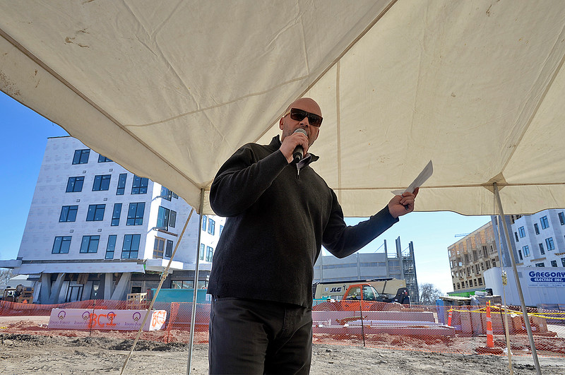 "Jay Hardy, president of Brinkman, speaks to a crowd of people about The Foundry redevelopment project Wednesday, March 7, 2018, while celebrating the ""topping out"" of The Foundry's two mixed-use/apartment buildings and the parking garage, and the groundbreaking for the hotel and the movie theater.  (Photo by Jenny Sparks/Loveland Reporter-Herald)"