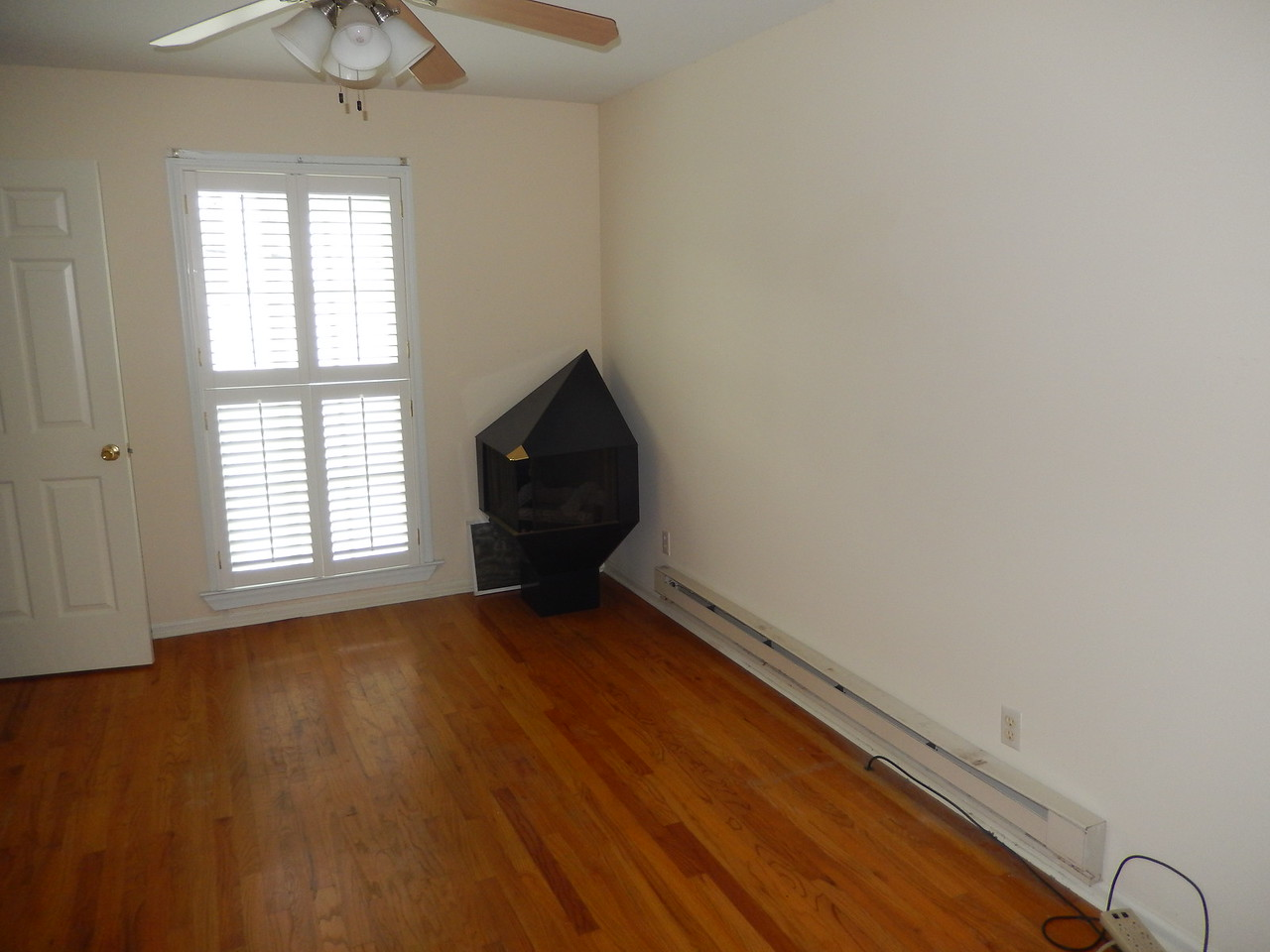 Living area.  Baseboard heating units to be removed.