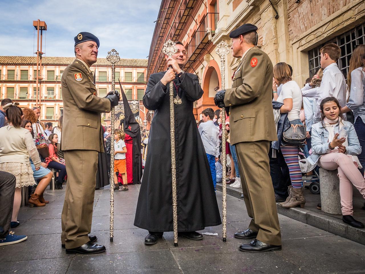 Officers and Priest in the Semana Santa Procession, Córdoba, Spain