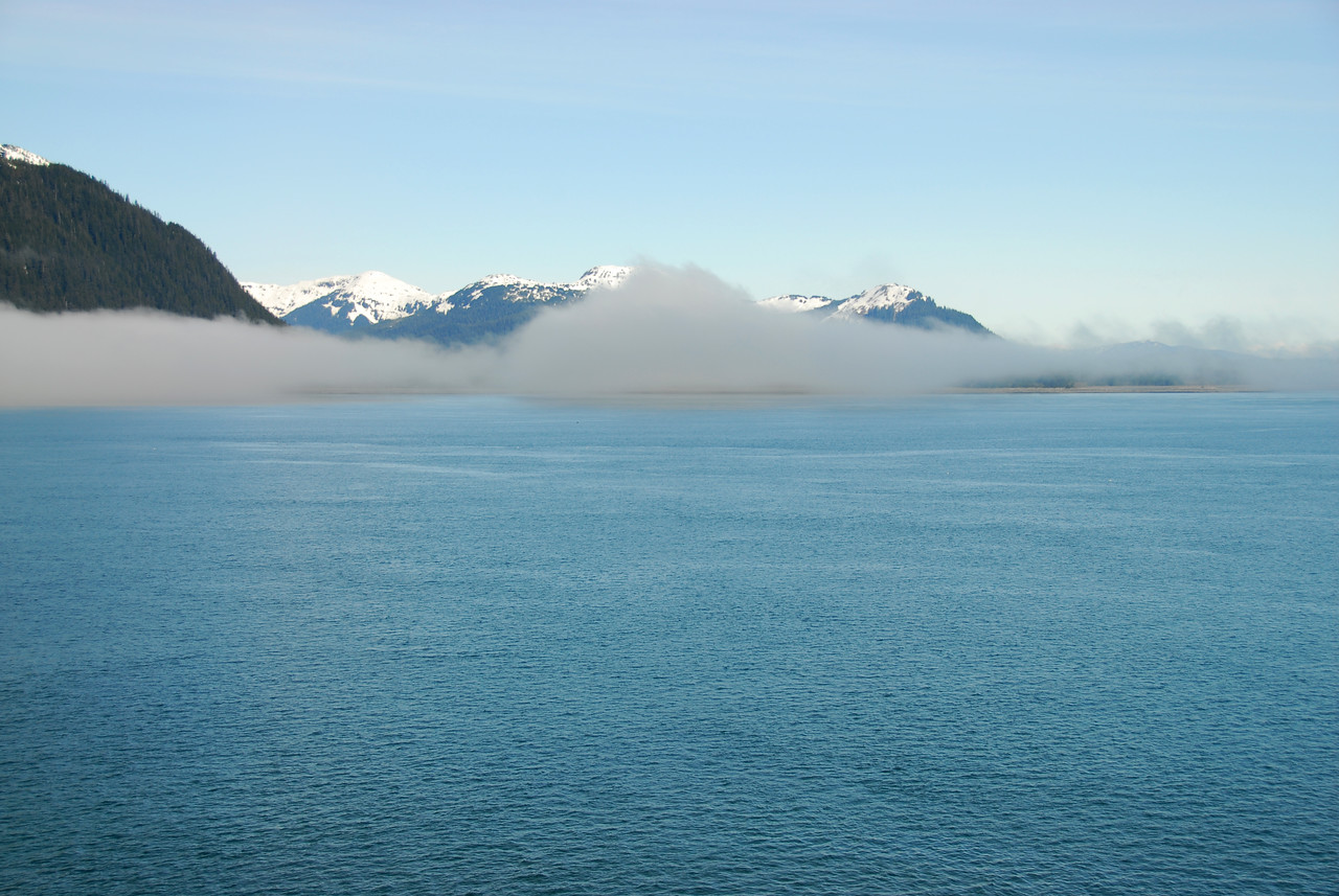 Moving further along into Glacier Bay the mist thickens. At this time a noticeable drop in temperature occurs.