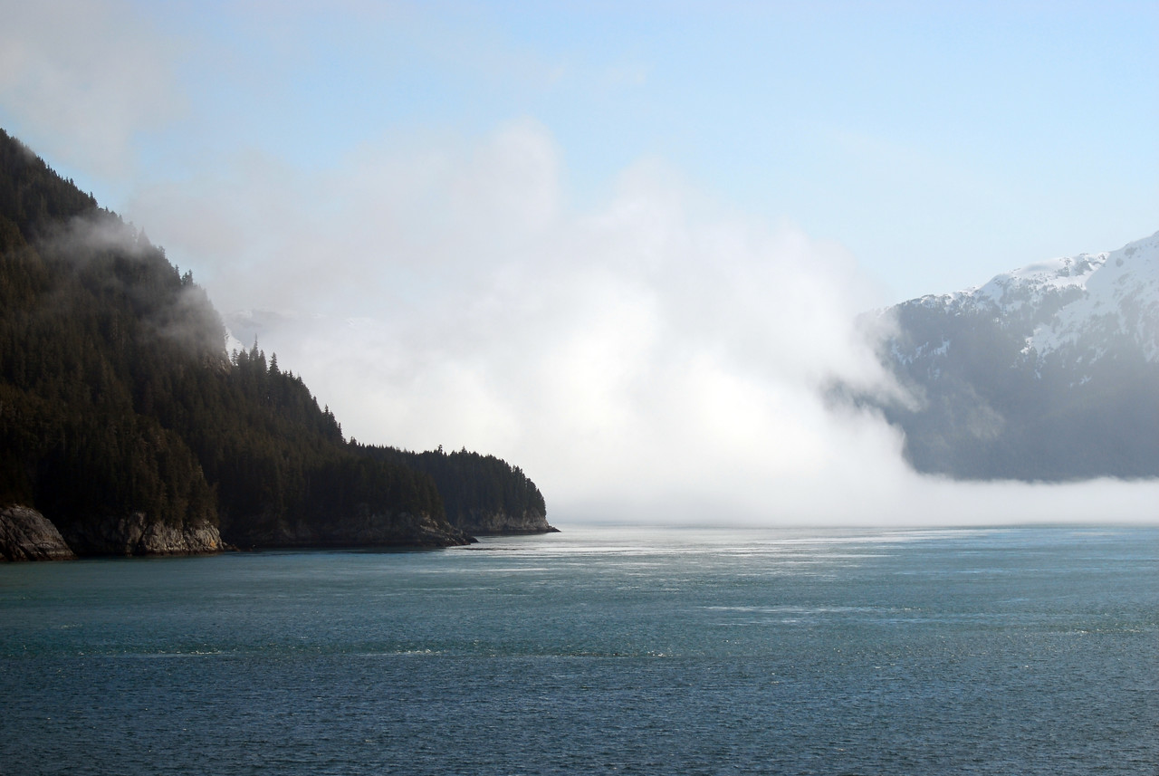 In this photograph it appears the mountain breaths smoke; actually this is a short distance from the entrance into Glacier Bay National Park