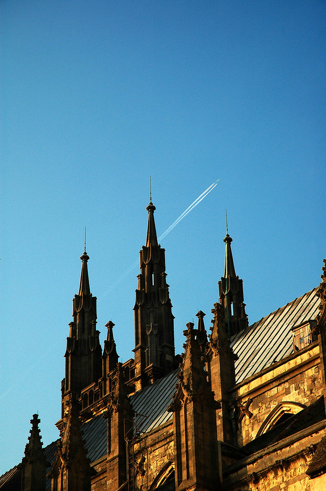 The church steeples in Canterbury with the modern jet tail stream in the background make for an interesting photograph. Old against new.