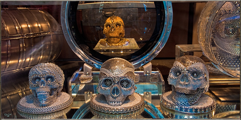 An Oddities & Antiques Store Window Display with Beaded Skulls