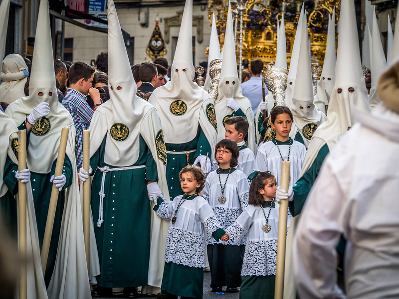 Children and Nazarenos in the Holy Week Procession, Córdoba, Spain
