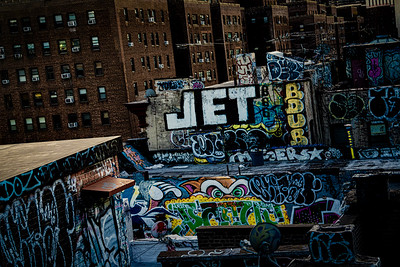 Jet Tag Over Rooftops