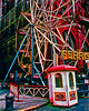 A Ferris Wheel At A Street Fair On Mott Street