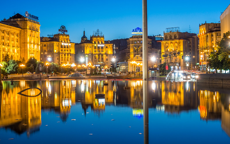 Buildings of the Maidan Reflected in the Monument Fountain, Kiev, Ukraine