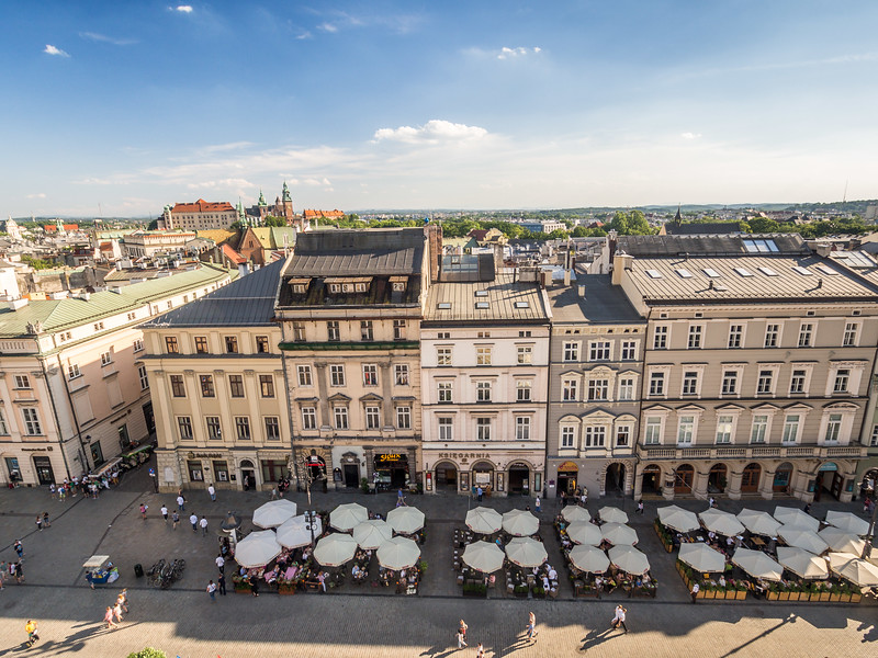 Restaurants on Rynek Square and Distant Wawel Castle, Kraków, Poland