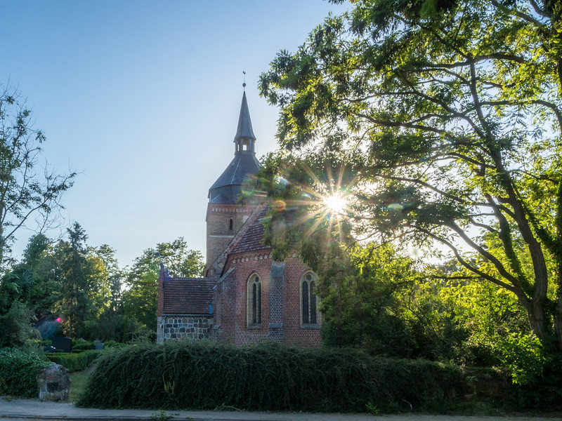 Sun behind the Old Church, Mecklenburg, Germany