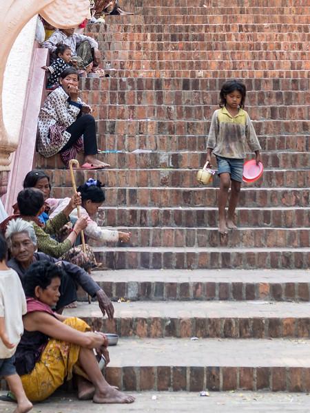 Little Girl and Beggars, Wat Phnom, Phnom Penh
