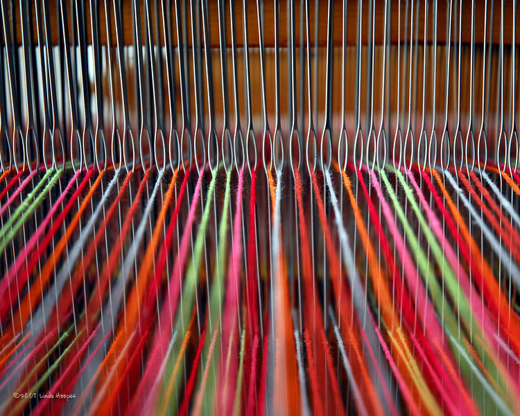 These threads lined up in anticipation of being woven into a beautiful tapastry  wait for the weaver's artistic hands to care for a weaver's nightmare. Can you spot the problem?