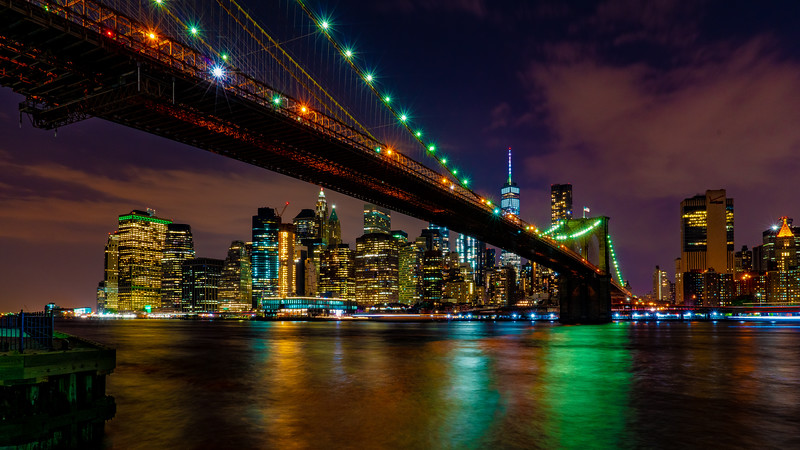 The Brooklyn Bridge and Lower Manhattan At Night