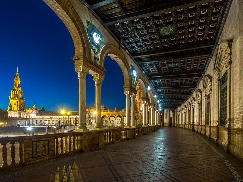 Night under the Arcades of the Plaza de España, Seville, Spain