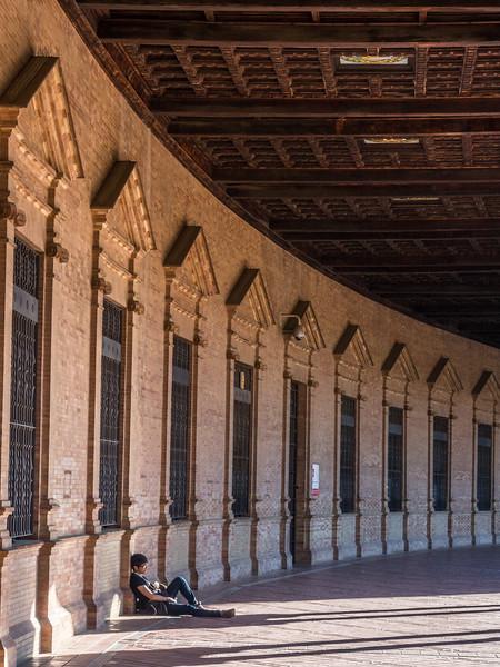 Rest Under the Arcades of the Plaza de España, Seville