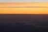 Flying above the clouds at dawn the sun puts on a show of magnificant colors changing moment by moment