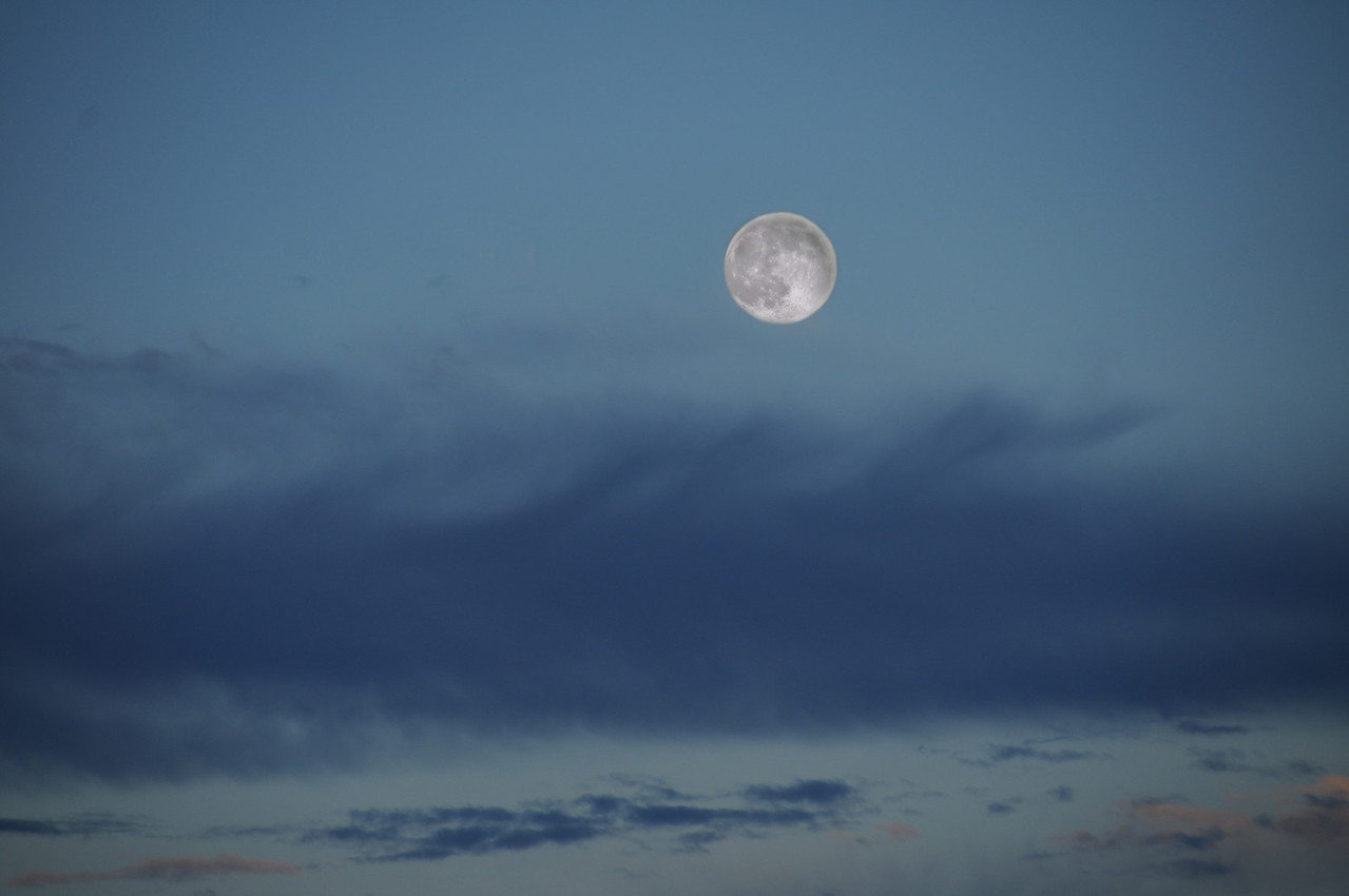 A full moon just at dusk makes for a spectacular contrasting photo