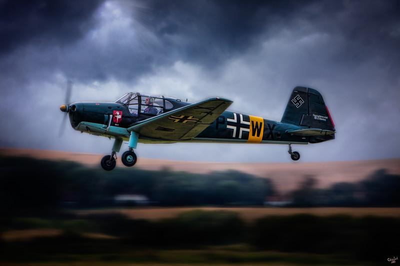 ME108 Takeoff Under Dark Clouds